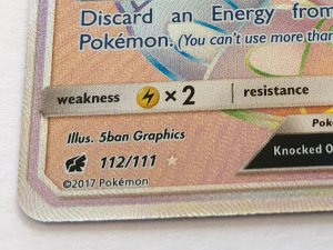 Secret rare Pokemon card number 112/111